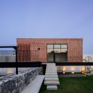 Delfino+Lozano's+Casa+G+features+an+elevated+brick+games+room