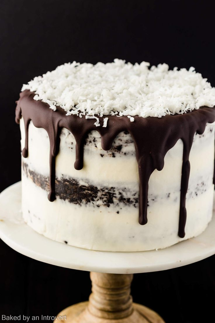 A Chocolate Coconut cake that is not only a show stopper, but it tastes great as well. Made from scratch chocolate cake layered with coconut pastry cream and covered in coconut buttercream frosting is truly exceptional.