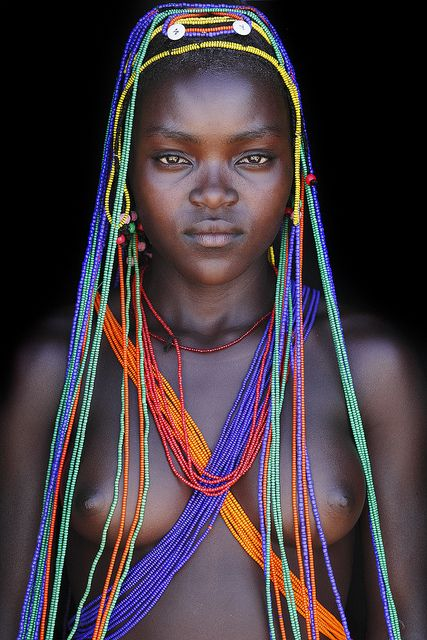 Nawo - a beautyful Mumuhuila youngh lady with electric beats / Chibia region - Angola
