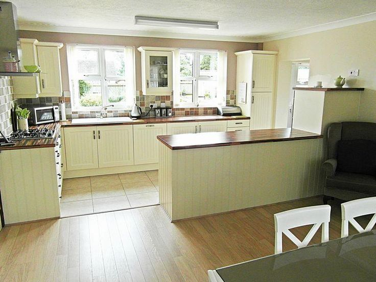 Photo of cream olive white kitchen with floor tiles for Cream kitchen wall units