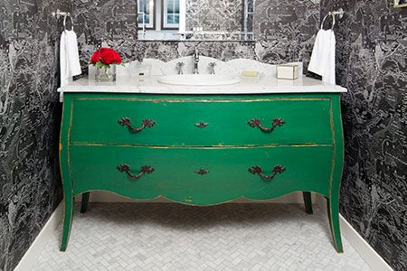 How to fit in the plumbing, make way for the trap and modify the drawers of a vintage dresser to turn into a showcase bathroom vanity.
