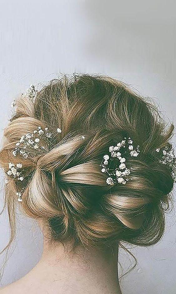 Braided Messy Bun with Baby Breath – 30 Best Wedding Bun Hairstyles – EverAfterG…