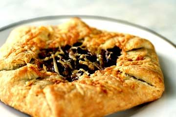 Rustic onion tart with caramelized red onions, Gruyere cheese, and an all-butter crust.