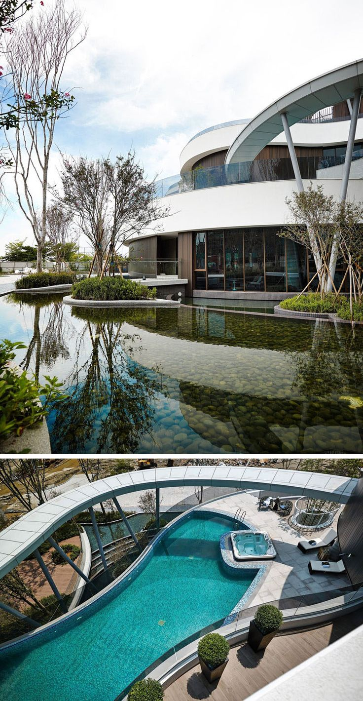 Glamorous bamboo fencing mode miami tropical landscape image ideas - This Clubhouse Is Surrounded By A Landscaped Pond That Can Also Be Seen From The Tropical Architecturelandscape