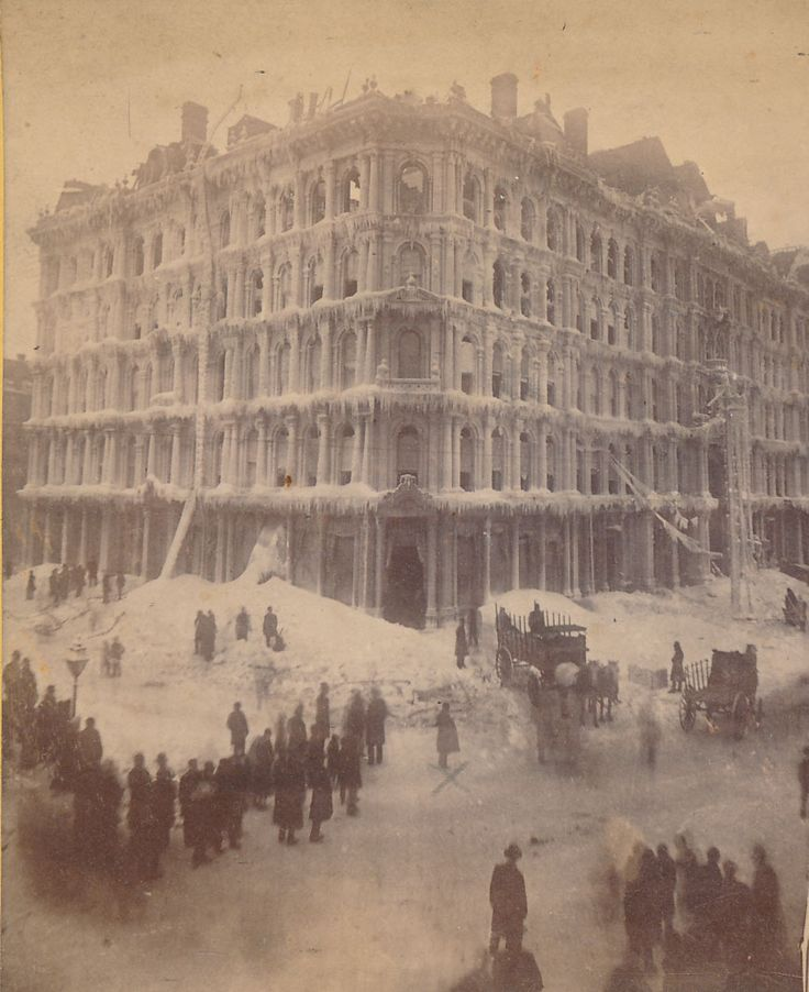 The Palmer House, gutted by the Great Fire of 1871, is encased in snow and ice during a winter storm, 1872, Chicago