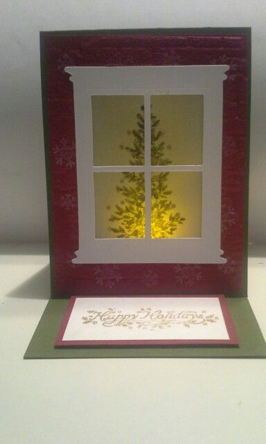 "This triple flap easel card took some time, patience, measurements & a lot of layering.  The back side of window flap was covered with dsp to look like wallpaper.  Electric tea light illuminates behind tree. Used ""balls"" from warmth & wonder then stamped lovely as a tree on vellum."