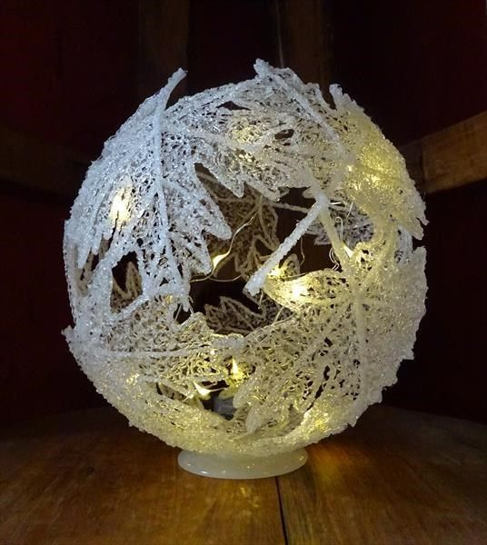 Filigree Leaves Sculpture by Paula Horsley. 3D pen with ABS filament. Lacy, frosted leaves illuminated with fairy lights. Ethereal and magical artwork.