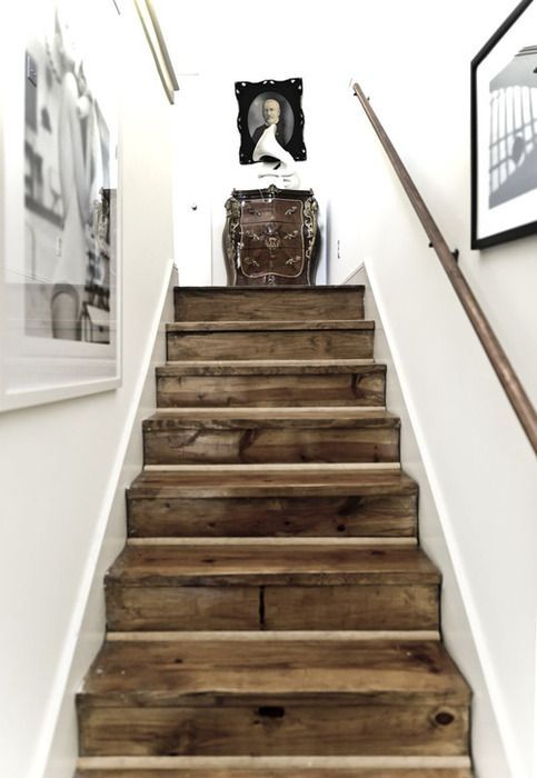 GORGEOUS reclaimed barn wood stairs....I love the look of stark white agains a knotted, brown wood in a distressed nature. Post on all different ways to use reclaimed barn wood or recycled wood in your home decor.
