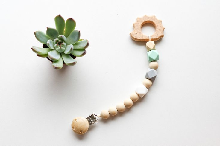Silicone and Wooden Teether clip    Your little one will love the variance of sizes and styles of the beads being busy to grab and chew on the new best animal friend.    Silicone teether, Wooden Toy Clip, Soother Clip   Wood and Mint silicone beads