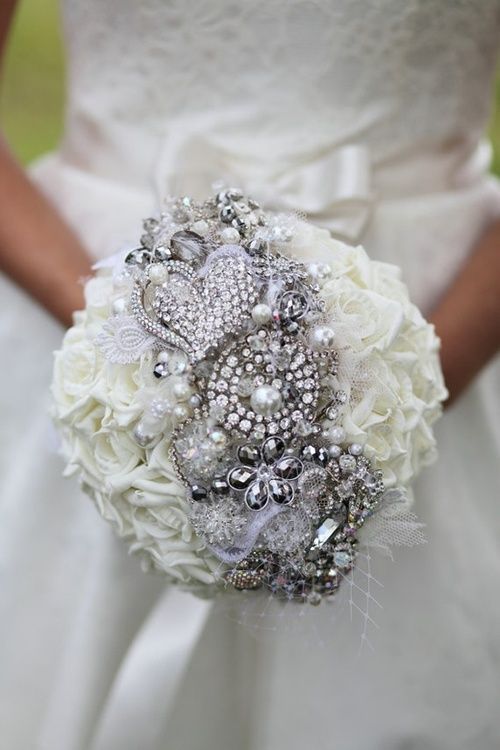love the brooch placement, with all white