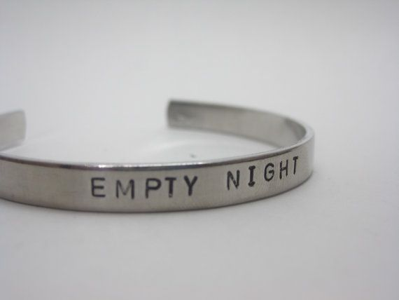 Simple cuff stamped with this Dresden inspired message Empty Night. Inspired by Thomas of Jim Butchers Dresden Files series. • Cuff is aluminum and hand stamped with this literary inspired message. • It is approximately 6 by 1/4 and should fit most people . • The metal is somewhat flexible and can be bent gently for a better fit. For a custom bracelet, see this listing: https://www.etsy.com/listing/196296852/custom-stamped-cuff?ref=listing-2
