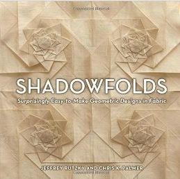 Shadowfolds. Book on fabric origami