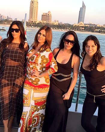 Kim Kardashian's world tour landed in Dubai on Friday, Nov. 21, and the reality star, decked out in a bikini, sailed the seas on a yacht with friends including actress Michelle Rodriguez; see the pics