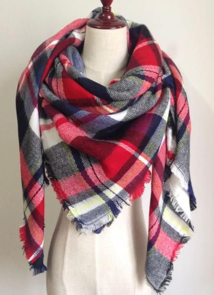 This extra soft scarf is perfect to keep you warm and stylish the whole water and fall season. Tis scarf is plaid with red, black, and white.  Size: 55 inches by 55 inches