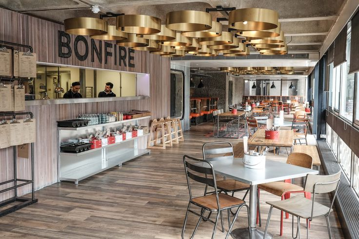 A complete transformation of the existing tapas to create a fast, casual, counter-based chicken and burger restaurant – a place to grab a quick bite between shows.  Feature oversized lighting, reclaimed timbers, industrial furniture and corrugated metals blend to give a utilitarian feel to the space.