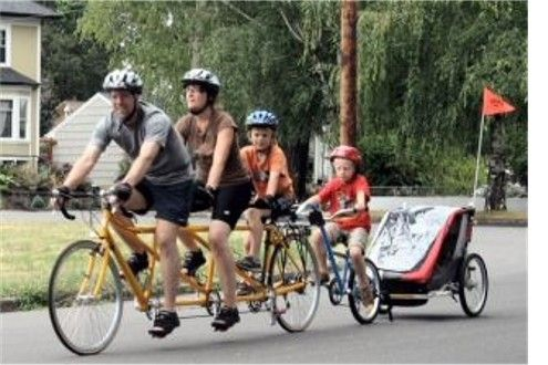 Here They Are On Their Family Tandem