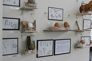 Displaying children's work on little shelves, accompanied by a simple narrative and the children's own writing.