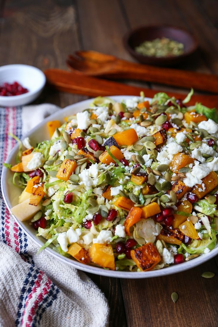 Shaved Brussel Sprout Salad with Roasted Butternut Squash, Pomegranate Seeds, Pumpkin Seeds, Feta, and Citrusy Maple Cinnamon Dressing