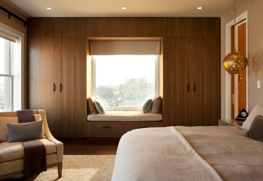 Contemporary bedroom window reading nook by De Meza + Architecture