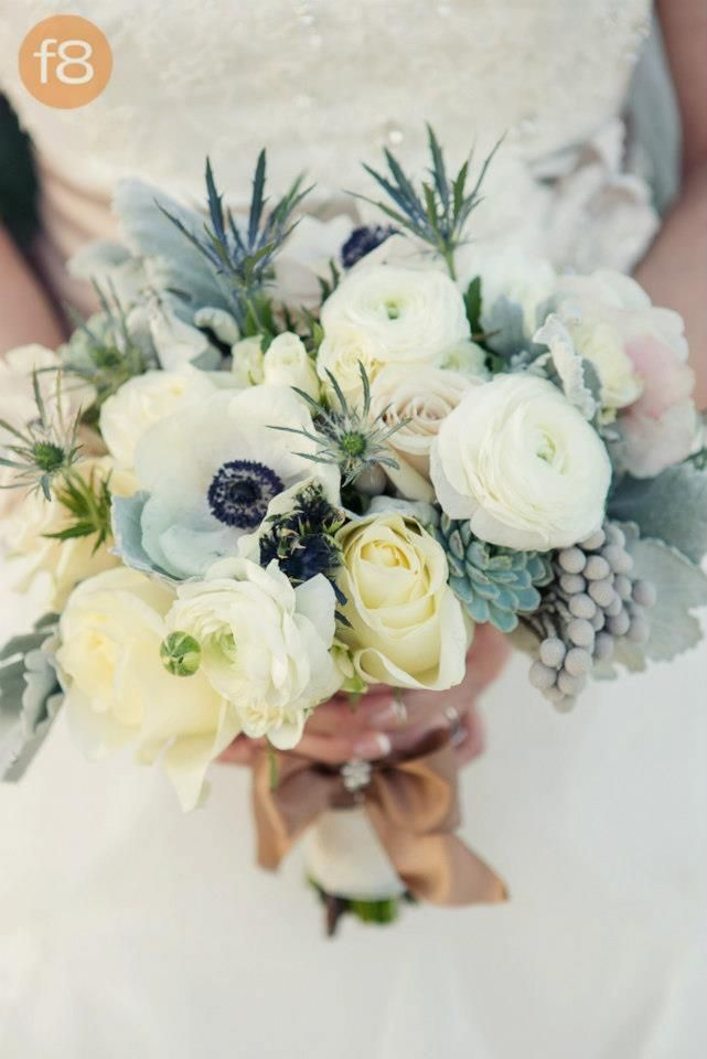Bridal bouquet with anemones, sahara roses, dusty miller, succulents, white chocolate roses, silver brunia, blue thistle, & ranunculus. rustic, vintage.
