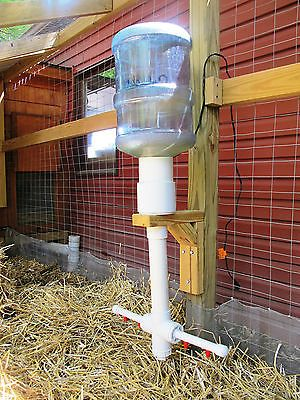 Automatic Heated Chicken Waterer 5 Gallon Nipple Gravity Watering 200-Watt 120V. This is on ebay. I pinned it for those of you who can 'eyeball' something then build it.. You know who your are!  Smarty pant's.. :)