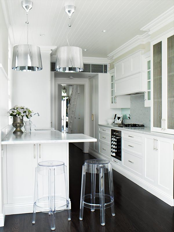 White beadboard ceiling, sharker style cupboards, large pendants in small kitchen