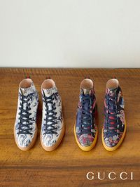 Featuring prints inspired by vintage Asian tapestries, Gucci high-top sneakers detailed with an image of Donald Duck from the Spring Summer 2017 collection.