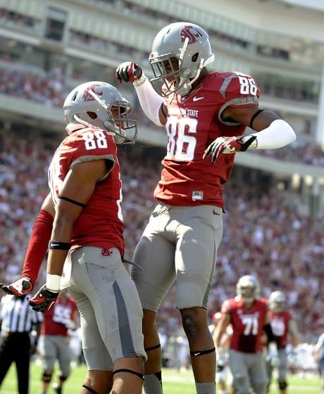 Washington State wins its 2012 home football opener against Eastern Washington, 24-20. Isiah Myers (88) celebrates with teammate Marquess Wilson after he scored the Cougars' first TD.  Gallery by Jesse Tinsley and Colin Mulvany, The Spokesman-Review. #spokane #wsu #ewu #cougars #eagles