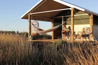 Ocean view cabins with outdoor veranda to retreat after a day full with adventures
