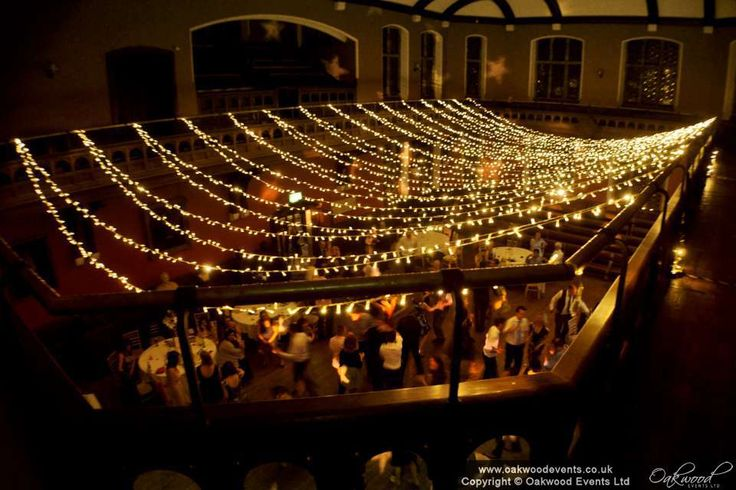 Looking down over the wedding in full swing in the Debating Chamber, through a ceiling of sparkling lights!