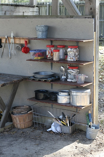 Mud pie kitchen - fully stocked with utensils, pots, pans and many other materials. Imitating adults in their life cooking and creating their own concoctions.