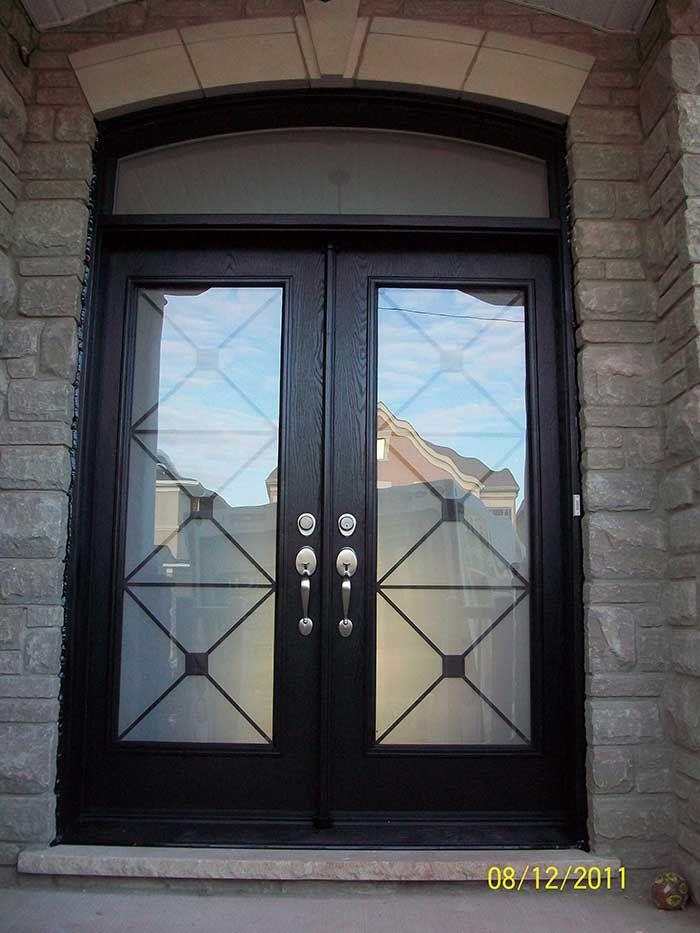 Fiberglass woodgrain double doors with iron glass design for Front door arch design