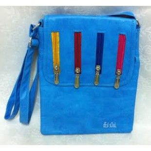 Stylish and trendy leatherette sling bag with a flap and accessorized with zips to make a fashion statement.  It has a zip closure inside and at the back side of the bag.  Buy Blue sling bag| Buy Slings bags Online | Buy Bags for woman online in India at www.innshoppe.com