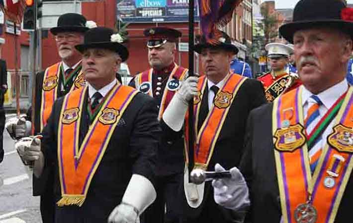 Orange Order complains about Catholics in Northern Ireland's civil service  A new report claims Protestants feel there is a double standard in the acceptance of cultural practices.