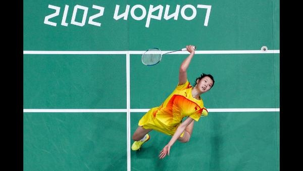 Xuerui Li of China returns a shot against Pui Yin Yip of Hong Kong, China in their Women's Singles Badminton quarter final on day 6 of the London 2012 Olympic Games at Wembley Arena on August 2, 2012 in London, England. (Photo by Chris McGrath/Getty Images)