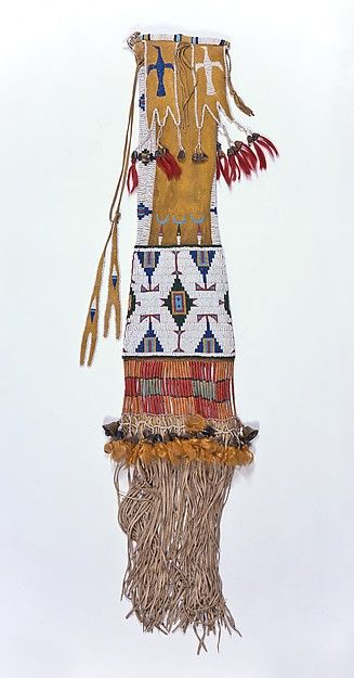 Tobacco Bag Date: ca. 1890 Geography: United States, Oklahoma Culture: Southern Cheyenne Medium: Native-tanned leather, glass beads, cornhusk, pigment, deer hooves, sheep hair