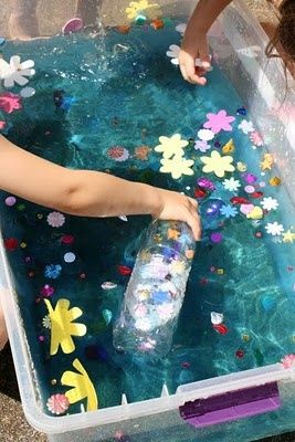 Treasure tank play-use larger play toys for toddlers.  Fun idea since we don't have a water table.  Great for little girls at a pirate birthday party!  @Aimee Lemondée Gillespie