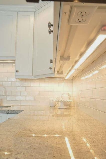 Put outlets under the cupboards, and keep a clean look for your backsplash.