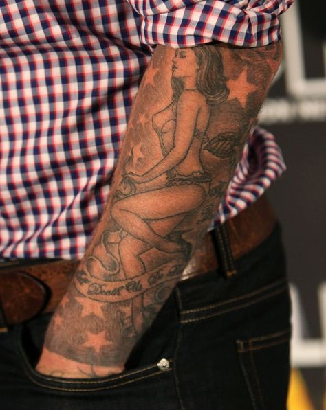 Pin for Later: Your Ultimate Guide to David Beckham's Tattoos David paid tribute to his wife with a sleeve of a lingerie-clad Victoria on his left arm.