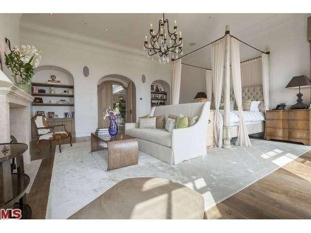 Gisele Bundchen and Tom Brady's bedroom decor... love the tufted headboard and draped 4 poster