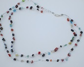 Crochet wire multi-strand necklace with millefiori glass chip beads.
