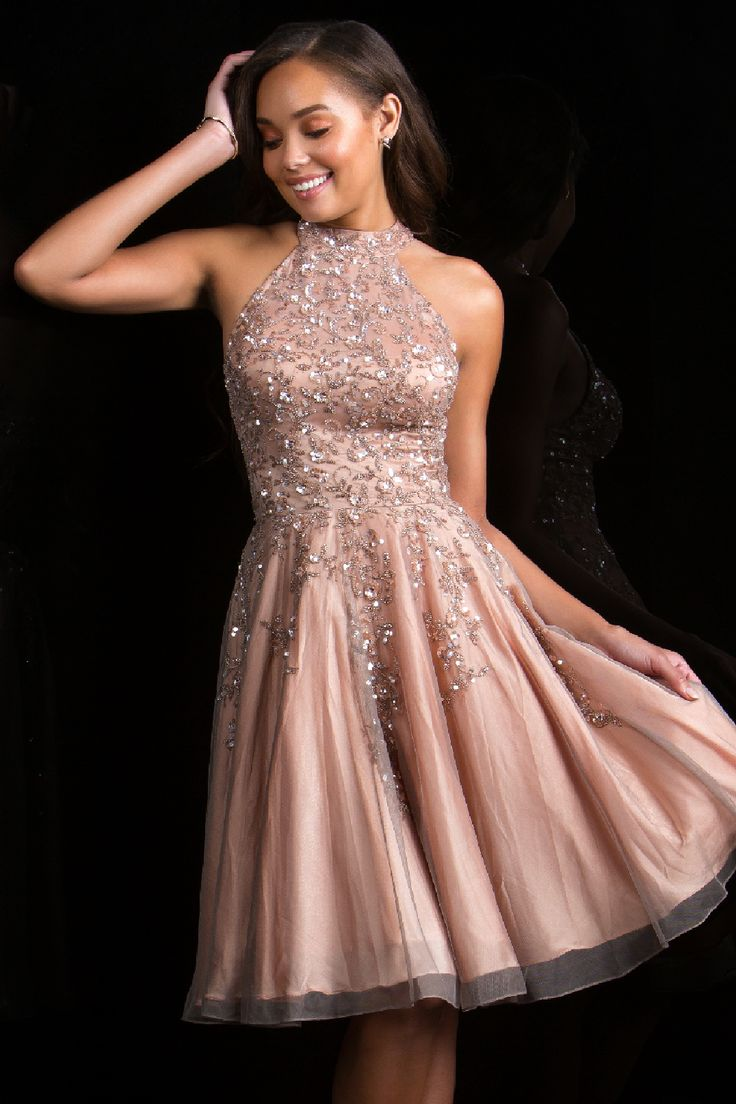 Prom Dresses Evening Dresses by SCALA<BR>asc48822<BR>Illusion sheer short beaded sequins dress with high neckline and a full volume overlay skirt.