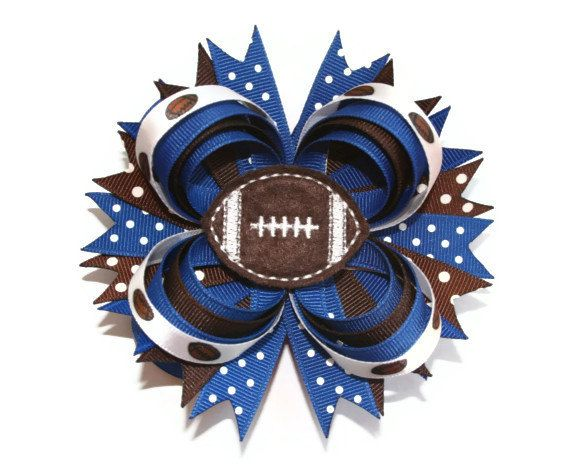 Hey, I found this really awesome Etsy listing at http://www.etsy.com/listing/154547075/football-hair-bow-football-hairbow-team