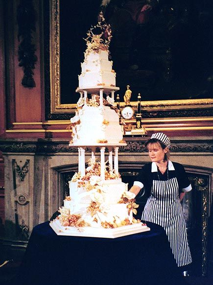 No English wedding fruitcake for HRH Prince Edward and Miss Sofie Rhys-Jones after their wedding on June 19, 1999. They selected a 7 tier Devil's food cake for their official cake that was topped with tennis rackets in a nod to the fundraiser where they met. The 10 ft creation took baker Linda Fripp and her staff 515 hours to create. Continuing to break with tradition, the Royal couple cut their cake PRIOR to serving dinner, something that is downright twenty first century.