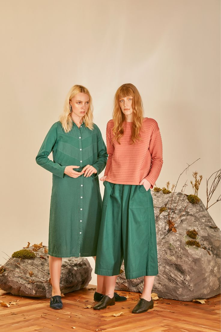 YM Fashion style their models in outfits perfect for casualwear. One in an emerald green shirt dress and the other in emerald green culottes paired with an orange jumper.