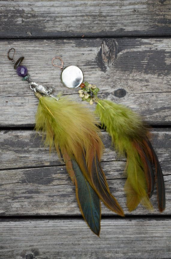 Long, green feathers earrings
