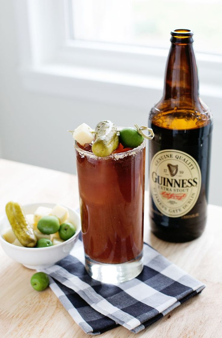 Guinness Bloody Mary  2 cups Bloody Mary mix 1 pinch garlic powder 1 pinch black pepper 1 pinch cayenne pepper juice of half a lime  1 ounce vodka 1 drop liquid smoke  3 oz Guinness Extra Stout
