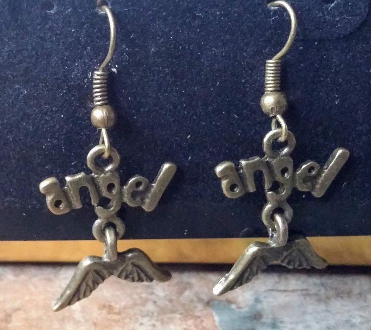Angel drop earrings  with a linked pair of wings under the word, handmade bronze earrings by SpryHandcrafted on Etsy