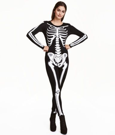 Black/skeleton. Fitted jumpsuit in jersey with a printed design. Opening at back of neck with button.