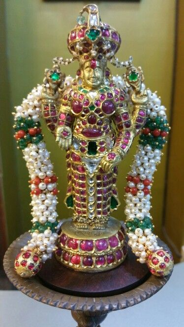 Perumal gold statue with Natural Ruby, Diamond, Emerald, Pearl, coral, and blue sapphire....
